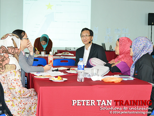 Peter Tan facilitating a DET workshop